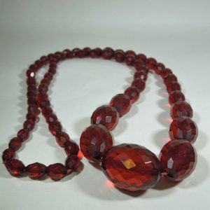 Long Faceted Cherry Amber Beads